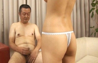Azumi Harusaki strokes a guys cock before taking it in her mouth