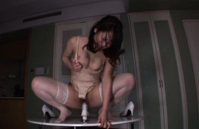 Japanese av model. Pleasant AV Model in lustful lingerie rides a dildo right on the table