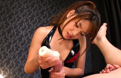 Nanami sakura. Nanami Sakura Asian in red and black latex strokes heavy penis